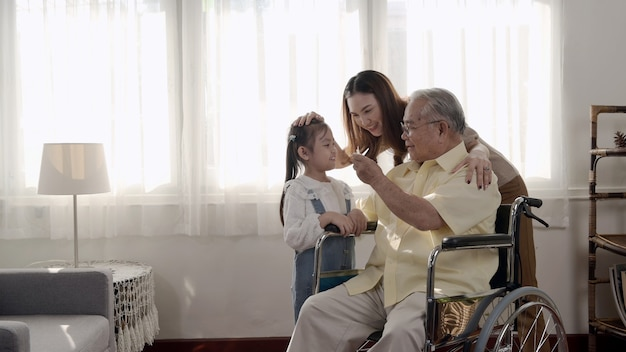 Asian senior man was sick and sitting on wheelchair. retirement age lifestyle and togetherness with family at home.