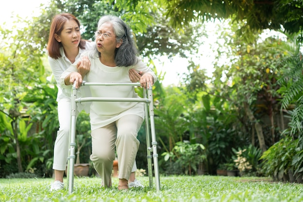 Asian senior woman falling down at home in the backyard caused by myasthenia