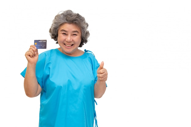 Asian senior woman patient holding credit card and thumb up isolated on white background.