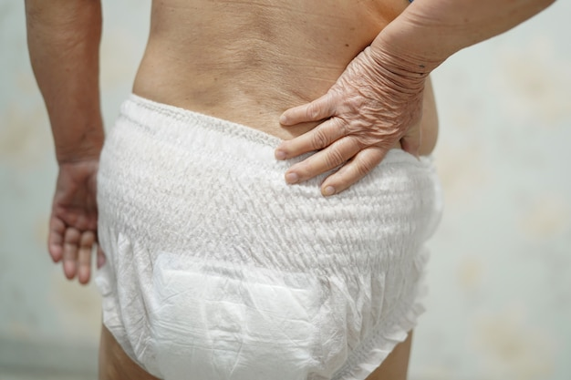 Asian senior woman patient wearing incontinence diaper in hospital.
