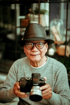 Asian senoir old man retirement doing photo