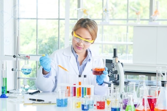 Asian Serious female chemist working in laboratory