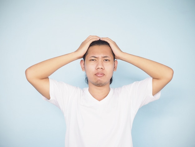 Asian serious young man worry and get headache.