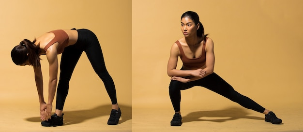 Asian slim fitness woman exercise warm up stretch arms legs, studio lighting yellow beige mustard background shadow copy space, concept woman can do athlete sport 6 packs