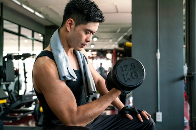 Asian sports man work out in gym