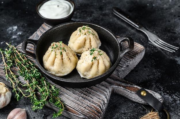 Asian steamed dumplings manti in a pan
