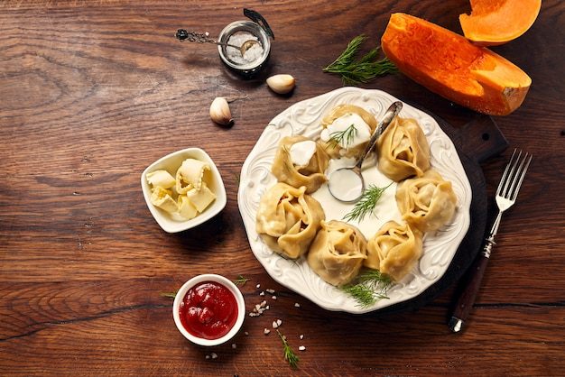 Asian steamed dumplings manti with pumpkin and garlic.