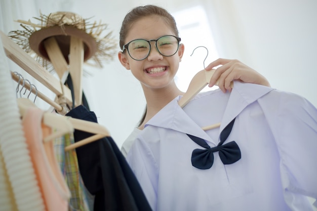 Asian student choosing and dressing school uniform prepare to go school, back to school