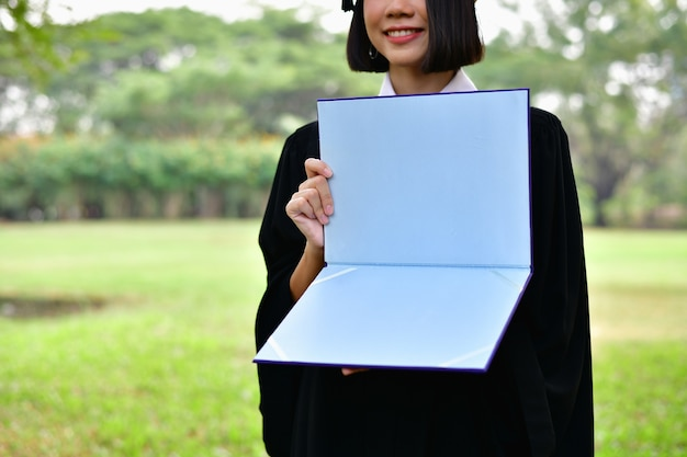 Asian students are smiling happily on the graduation day