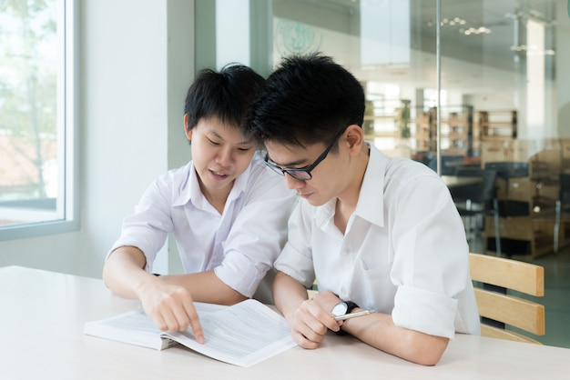 Asian students studying together at university.