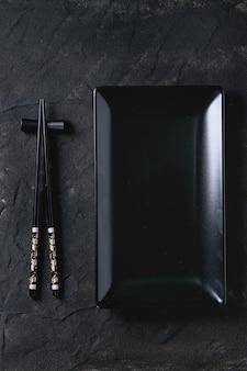 Asian tableware over black