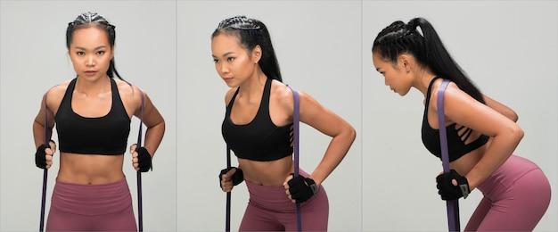 アジアンタンスキンフィットネス女性エクササイズウォームアップストレッチレジスタンスバンド腹筋着用ブラックスポーツブラマルベリーパープルパンツ、スタジオ照明グレー背景コピースペース、コンセプトwoman can do sport6パック