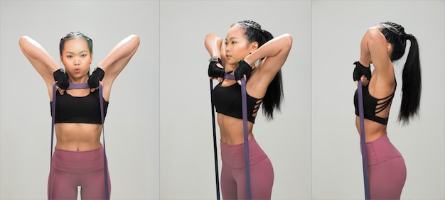 Asian tan skin fitness woman exercise warm up stretch resistance bands abs wear black sport bra mulberry purple pants, studio lighting gray background copy space, concept woman can do sport 6 packs