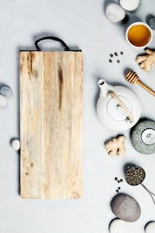 Asian tea set and spa stones on concrete background