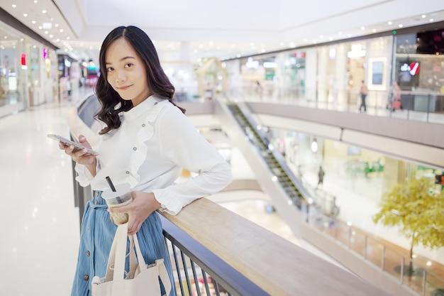 Asian teenage urban behavior like shopping drink coffee