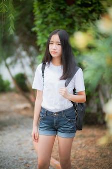 Asian teenager wearing short jeans standing outdoor