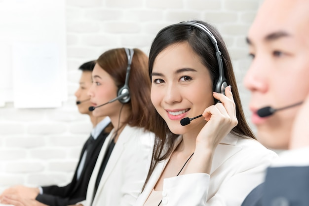 Asian telemarketing customer service agent team working in call center