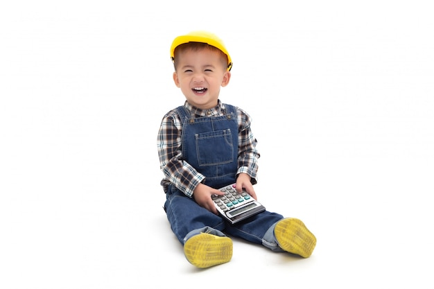 Asian thai baby boy wearing an engineer suit with hard hat