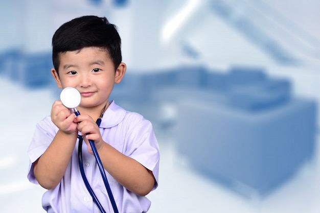 Asian thai kid with medical stethoscope