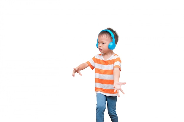 Asian toddler boy child listening to music in headphones