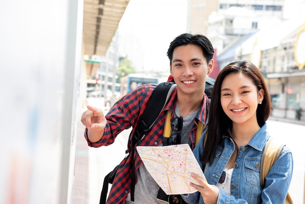 Asian tourist couple backpackers taveling in bangkok city thailand