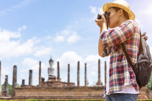Asian tourist man in sukhothai historical park, thailand