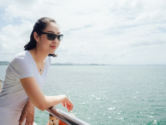 Asian tourist woman on the ferry is on the way for sea trip