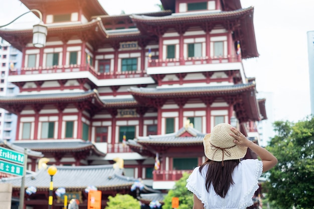 Asian traveler looking to buddha tooth relic temple in chinatown singapore