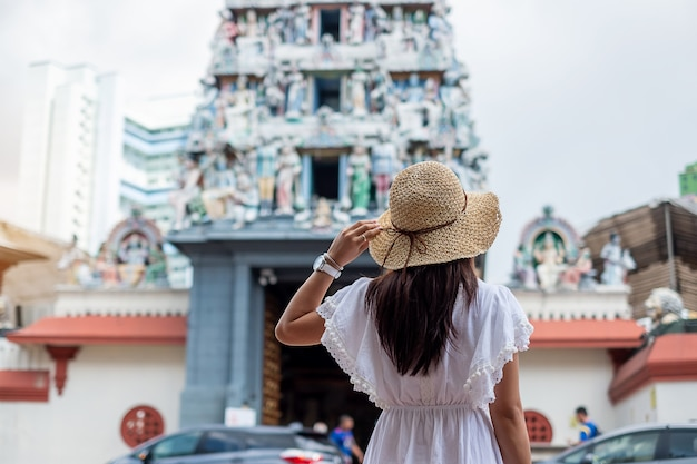 Asian traveler looking to sri mariamman temple in chinatown of singapore