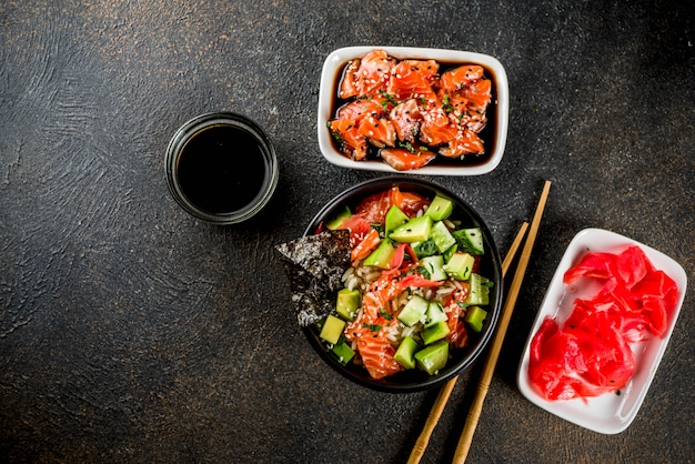 Asian trendy food, sushi poke bowl with cucumber, salmon, avocado
