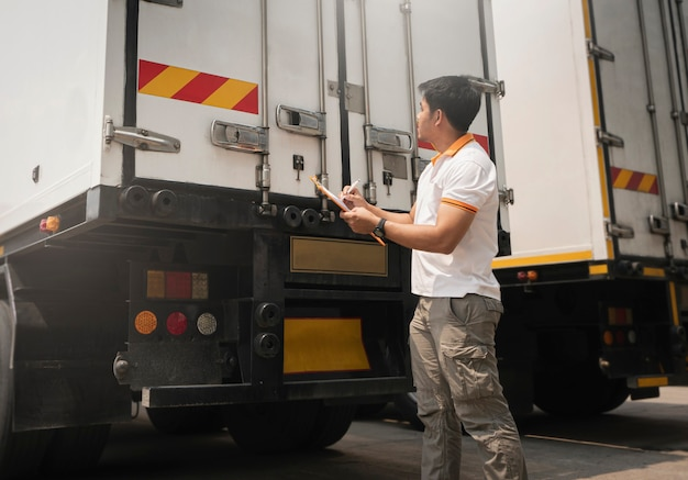 Asian a truck driver holding clipboard checking container door security truck inspection safety and maintenance