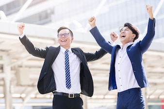 Asian two businessmen happy are working in city