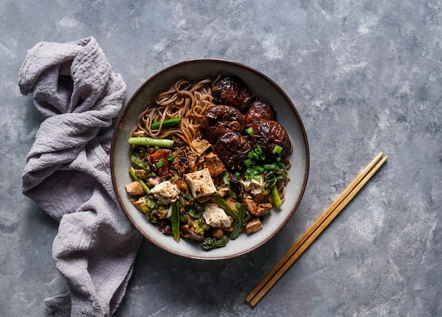 Asian vegan soba noodle  with tofu cheese, shiitake mushrooms