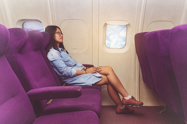Asian woman in airplane
