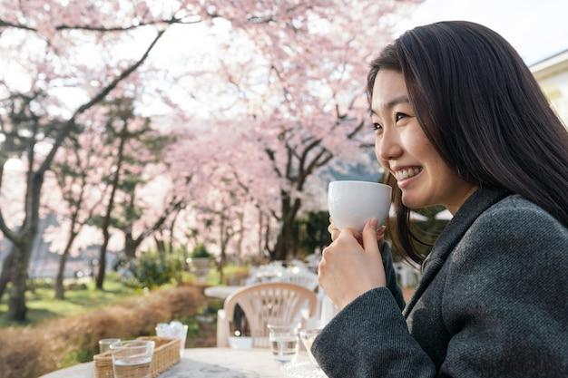 Asian woman appreciating the nature surrounding her
