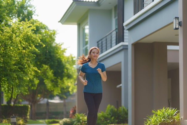 Asian woman are jogging in the neighborhood for daily health and well being, both physical and mental and simple antidote to daily stresses and to socialize safely.