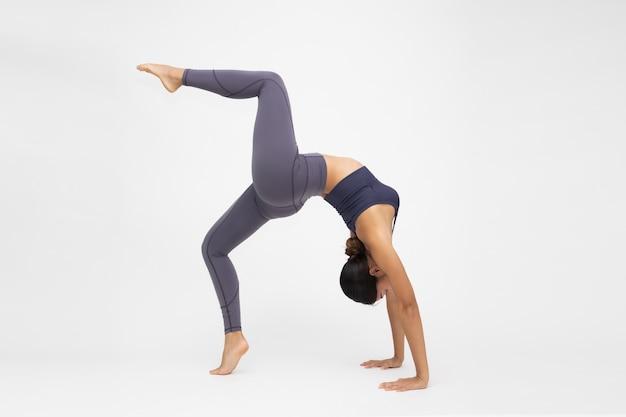 Asian woman are yoga exercises isolated on white background