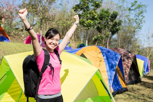 Asian woman backpack to go camping tent for do activity in summer camp.