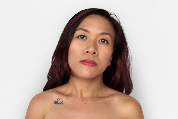 Asian woman bare chest topless studio portrait