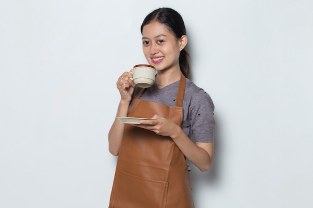 Asian woman barista wear aprona with cup of coffee cafe service concept