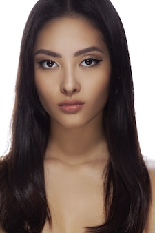 Asian woman beauty face closeup portrait beautiful young girl with bare shoulders and long hair