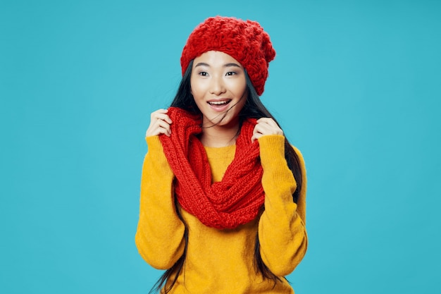 Asian woman on bright color surface posing model