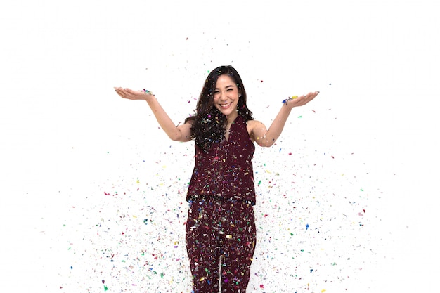 Asian woman celebrating with confetti colorful in festival.