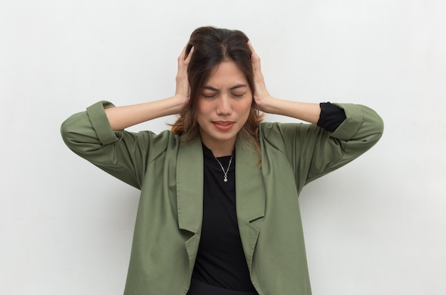 Asian woman covering her ears Premium Photo