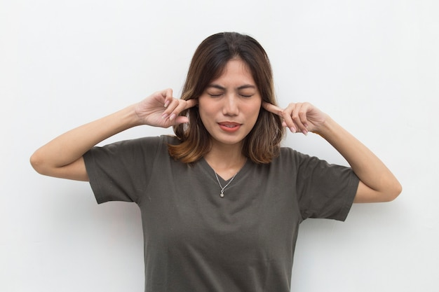 Asian woman covering her ears