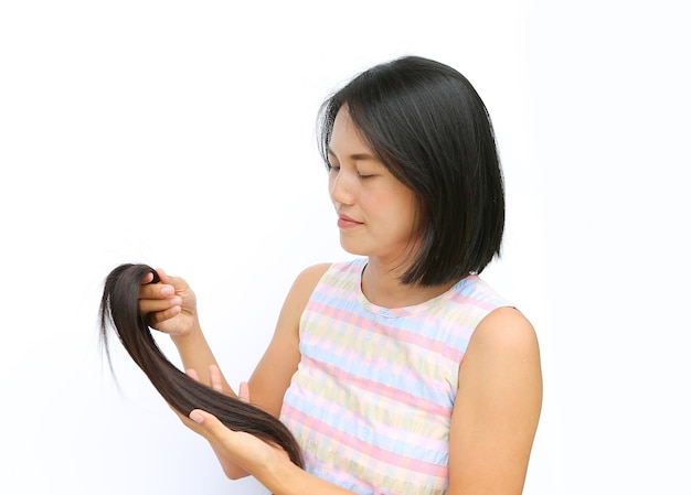 Asian woman donate hair to cancer patient on white background.