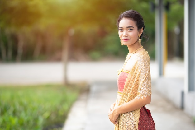 Asian woman dress in thai silk traditional costume