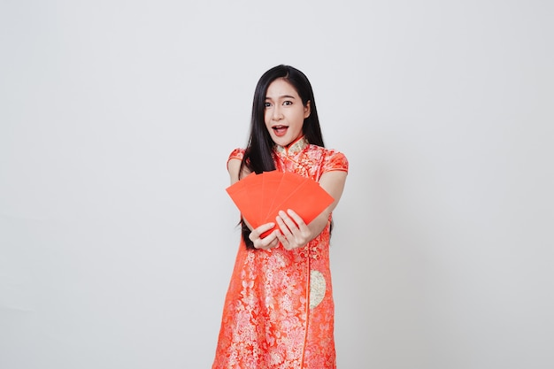 Asian woman dress traditional cheongsam on white