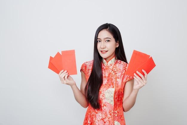 Asian woman dress traditional cheongsam on white