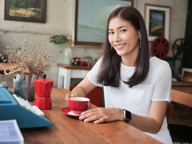 Asian woman drinking coffee in  coffee shop cafe